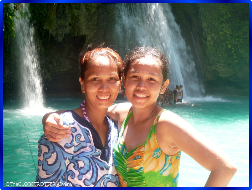 My mom and I with the background of the waterfalls in the lowest layer of Kawasan Falls.