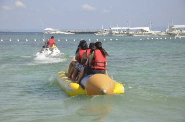 My Family and I are riding a Banana Boat against strong winds in Tambuli Resort, Mactan Island , Cebu.
