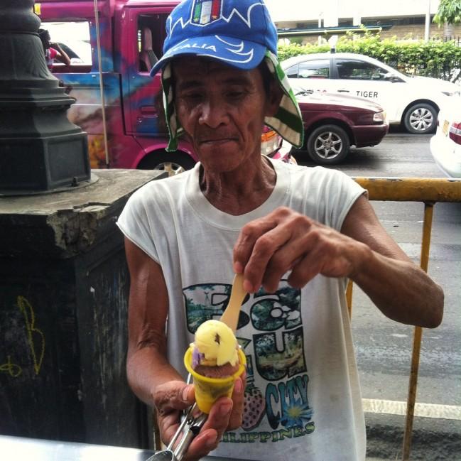 A Mamang Sorbetero scooping some sorbetes.