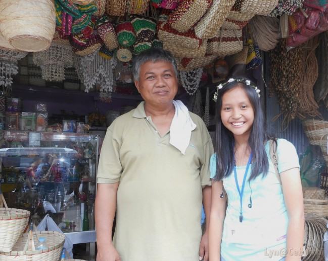With Mr. Cris Tora, a souvenir shop owner.