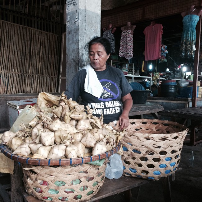 A Puso vendor waiting patiently for customers.