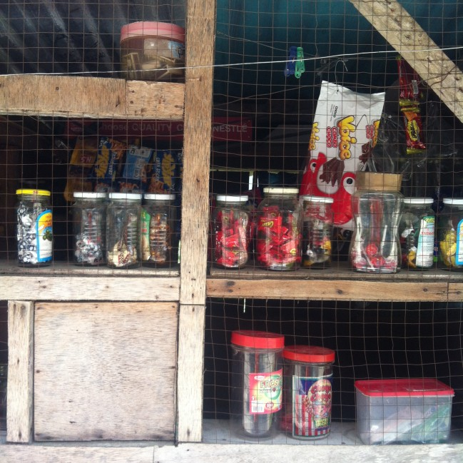 A small sari-sari store's window (bottom left) for receiving payments.