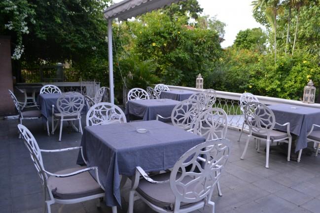 La Maison Rose's dining setting outside.