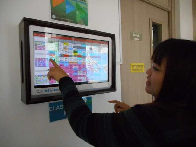 Our tour guide directs us to the different places in the school though the touchscreen directory.