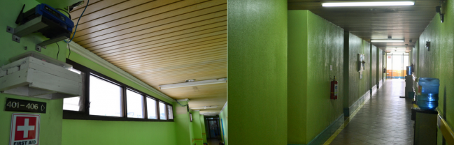 Several wifi routers and water dispensers are installed along the hallway of the dormitory.