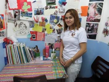 Teacher Angel inside her artsy classroom