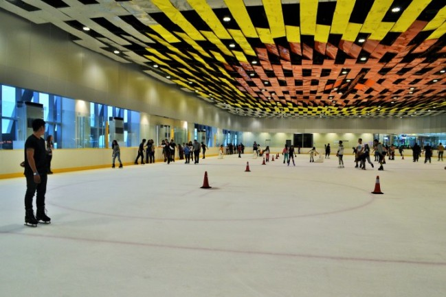 To prevent collisions, skaters must follow the counter-clockwise flow of traffic. The cones you see are intended to form a rectangular enclosure designated for other skaters such as those having ice lessons.