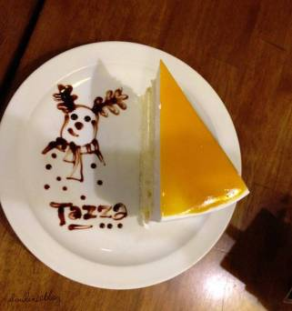 Here's a slice of Mango Mousse Cake with a smirking snowman etched at the side. Thank you for the warm-heartedness.